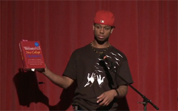 Terrell Patrick holds dictionary