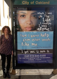 Genice Jacobs with anit-trafficking poster